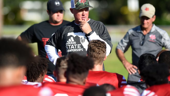 Vero Beach High School head football coach Lenny Jankowski talks with his players after morning practice, Monday, Aug. 7, 2017.