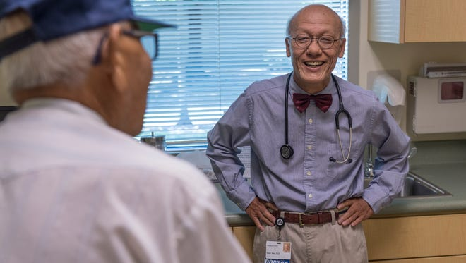 Dr. Shu-Dean talks with patient Gabriel Nunez on Thursday, August 17, 2017. Hsu is retiring from Sequoia Regional Cancer Center after 40 years of practice.