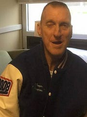 Donnie Whitworth shows off the McGavock letterman jacket he received on Sunday after being admitted into hospice care last week.
