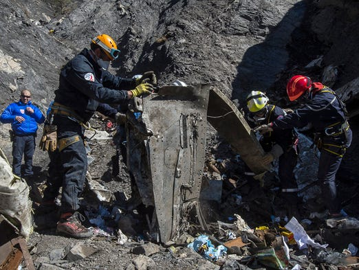 French rescue workers search through the debris of
