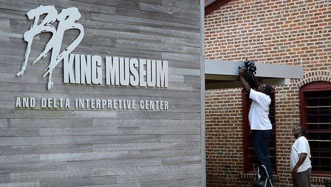 Workers hand a black ribbon outside the B.B. King Museum and Delta Interpretive Center in Indianola, Mississippi on Friday, May 15, 2015.