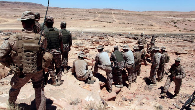 In this  June 18, 2013, file photo, U.S. Marines monitor Eager Lion multinational military maneuvers in Quweira, 186 miles south of Amman, Jordan.