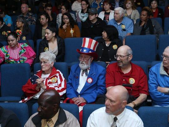 People listen to a presentation Saturday at El Paso