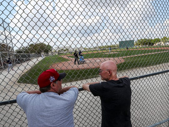 """(right)Jim Bartos, a fan of the Twins and of spring training, talks to a friend he made this week, as the minor league teams for Minnesota and Tampa Bay played each other. """"One of the beauties of spring training is who you will run into"""", Bartos said, """"I prefer practice over the games."""" Minor league camp can beat big-league camp from a fan's perspective. You can get up close to future big league players and all the action. Many spectators become friends and get an inside scoop to the future team."""
