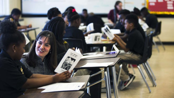 Tennessee Education Commissioner Candice McQueen talks with a student during a trip to Memphis.