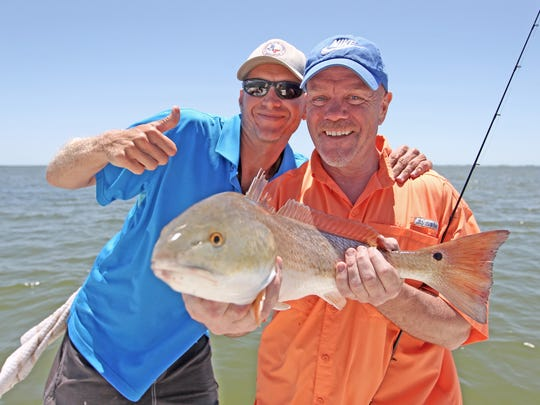 Anglers are just as likely to catch redfish as trout when throwing soft plastics.