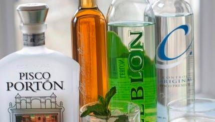 This April 28, 2014 photo shows, from left,  Pisco Portion, Leblon special reserve, a cachaca mojito made with Leblon cachaca, Leblon cachaca, Control original pisco premium and a pisco sour in Concord, N.H. (AP Photo/Matthew Mead)