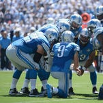 Quarterback Matthew Stafford and the Detroit Lions huddle before a play against the San Diego Chargers on Sept. 13, 2015, in San Diego.