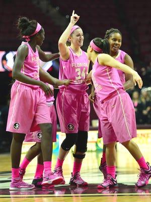 Gabby Bevillard's teammates surround her after her 3-point shot.
