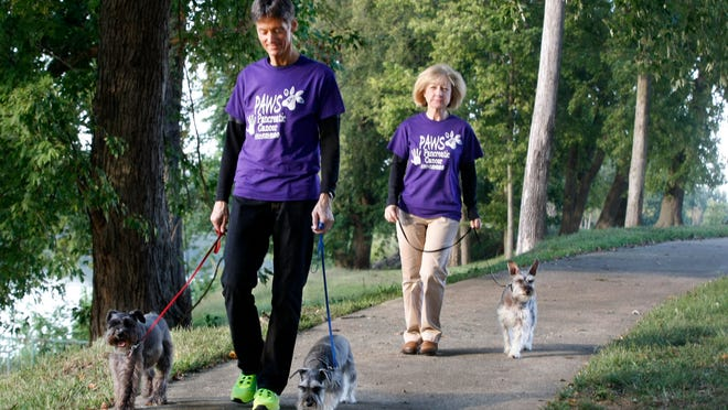 Dwight and Pam Berry walk with their miniature schnauzers at Liberty Park in preparation for PAWS 4 Pancreatic Cancer 3K fun walk/dog walk. The walk is to raise awareness for Pancreatic Cancer and is functioning as a Community Ambassador for the Pancreatic Cancer Action Network.