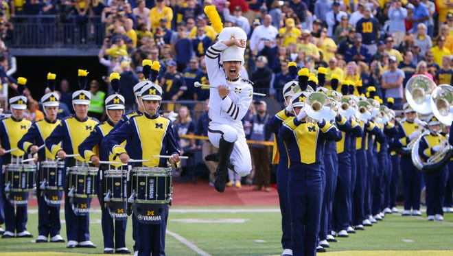 Drum major Kevin Zhang performs with the University of Michigan marching band on Sept. 9 before the Wolverines' home game against Cincinnati. Zhang, a 2014 Northville High School graduate, played trombone in the band for three years and was picked this year to lead the band on the field.