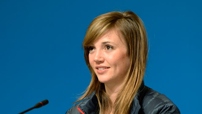 Gold medalist Kaitlyn Farrington (USA) speaks at a press conference for the ladies' halfpipe.