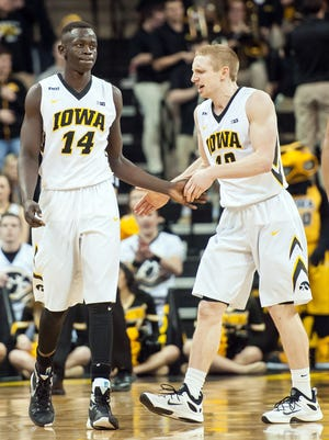 Iowa Hawkeyes guard Mike Gesell (10) congratulates guard Peter Jok (14) against the Nebraska Cornhuskers during the second half at Carver-Hawkeye Arena. Iowa won 77-66.