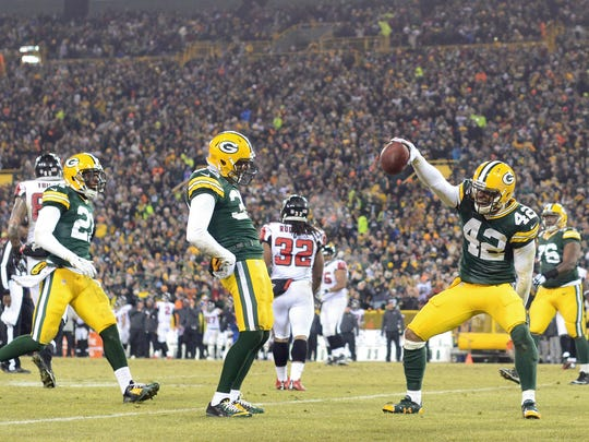 Green Bay Packers safety Morgan Burnett (42) celebrates an interception after the return with his teammates in the second quarter. The Green Bay Packers hosted the Atlanta Falcons at Lambeau Field in Green Bay, Wis. on Monday, Dec. 8, 2014. Kyle Bursaw/Press-Gazette Media/@kbursaw