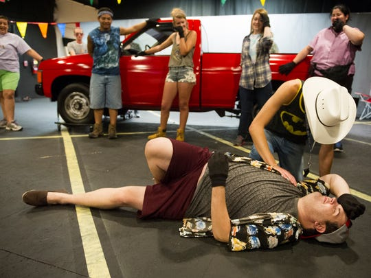 """Nolan Spinks, of Evansville, playing the role of Mike, (above), acts out a scene with Zach Bryant, of Evansville,  playing the role of Ronald, during rehearsal for Think Pink's """"Hands on a Hardbody"""" at Studio 321."""