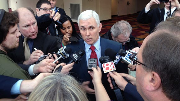 The news media interviews Ind. Gov. Mike Pence after his speech at the Legislative Conference luncheon at the Indiana Convention Center in Indianapolis on Thursday, Dec. 5, 2013.