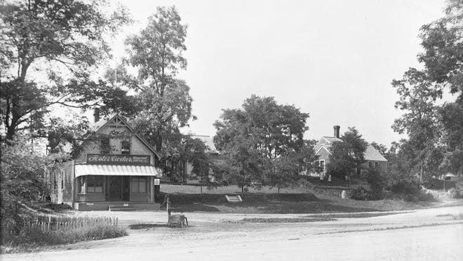 Intersection of River Road and Main Street/Route 149, c. 1905-1915. The water pump shown in front of the old Foster Crocker General Store site is still there today.