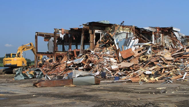 The Iconic McLoone's Rum Runner Restaurant on Rt. 36 south in Sea Bright, is demolished after being destroyed during Superstorm Sandy, Monday, July 21, 2014.