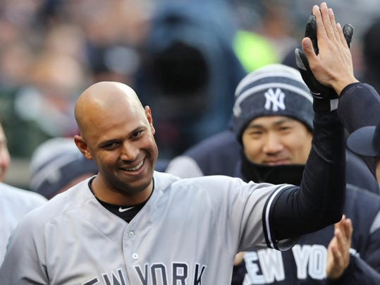 New York Yankees' Aaron Hicks is congratulated in the dugout after his inside-the-park home run during the second inning of a baseball game against the Detroit Tigers, Friday, April 13, 2018, in Detroit. (AP Photo/Carlos Osorio)