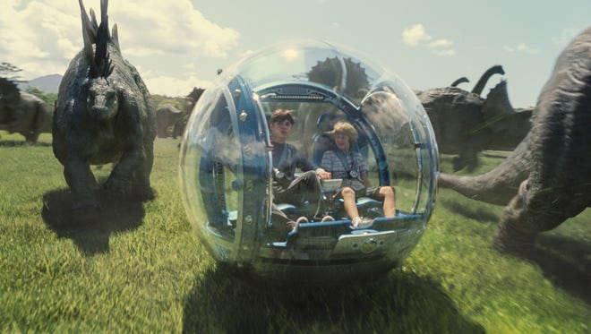 "AP Nick Robinson, left, as Zach, and Ty Simpkins as Gray, take a ride through ?Jurassic World,? the $1 billion latest installment in the ?Jurassic Park? series. This photo provided by Universal Pictures shows, Nick Robinson, left, as Zach, and Ty Simpkins as Gray, in a scene from the film, ""Jurassic World,"" directed by Colin Trevorrow, in the next installment of Steven Spielberg's groundbreaking ""Jurassic Park"" series. (ILM/Universal Pictures/Amblin Entertainment via AP)"