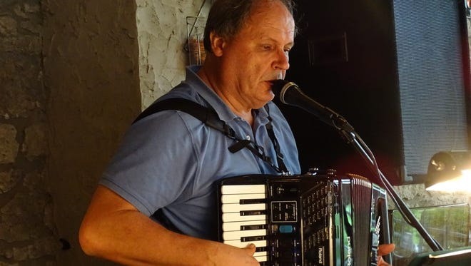 Paul Hupalowsky, of North Royalton, plays the accordion  as part of the North Coast Mix's polka performance at Oktoberfest at Mon Ami Winery.
