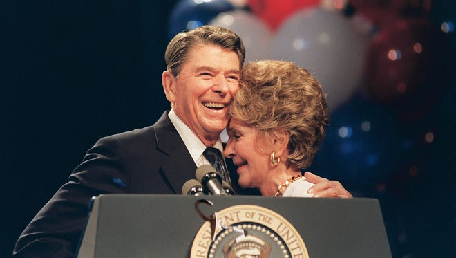 The Reagans share an embrace at a luncheon in New Orleans on Aug. 15, 1988. The former first lady died March 6.