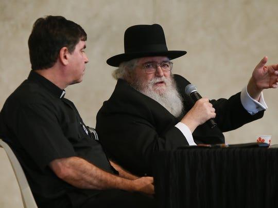 Rev. John Bambrick listens to Rabbi Phil Lefkowitz