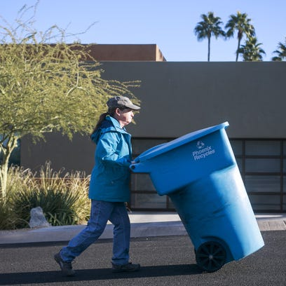 Phoenix resident Mary Westheimer wheels her empty recycling