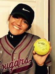Sydney Montoya holds the ball she hit for a grand slam