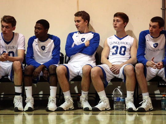 Desert Christian forward Will Whitaker, center, with his team on Wednesday, February 7, 2017 in Bermuda Dunes during their game with Palm Valley.