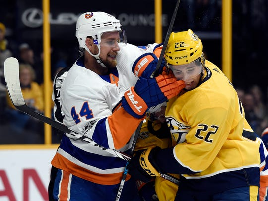 New York Islanders defenseman Calvin de Haan (44) scuffles with Nashville Predators left wing Kevin Fiala (22), of Switzerland, during the second period of an NHL hockey game, Saturday, Oct. 28, 2017, in Nashville, (AP Photo/Mark Zaleski)