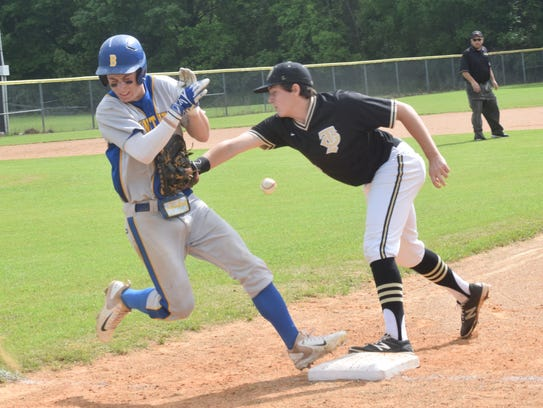 The ball falls out of the glove of Jena first baseman