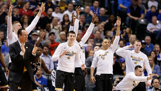Wichita State Shockers players celebrate from the bench against the Kentucky Wildcats during the second half in the second round of the 2017 NCAA Tournament at Bankers Life Fieldhouse on March 19.