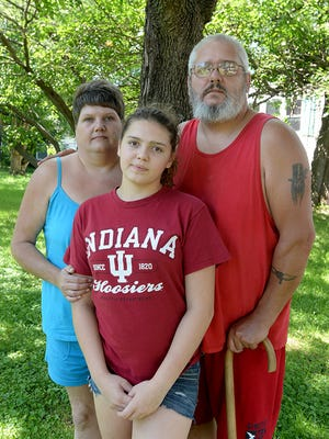 Marti Mills, from left, Abigail Mills and Gary Mills pose for a photograph Friday, July 24, 2015, in Richmond, Ind. Gary Mills said his 14-year-old daughter's behavior has improved since her shaming video was posted on Facebook and went viral.