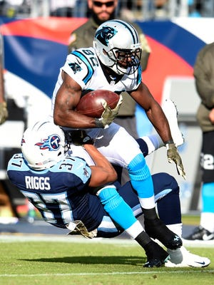 Titans cornerback Cody Riggs (37) tackles Panthers wide receiver Jerricho Cotchery (82) during the fourth quarter at Nissan Stadium Sunday Nov. 15, 2015, in Nashville, Tenn.