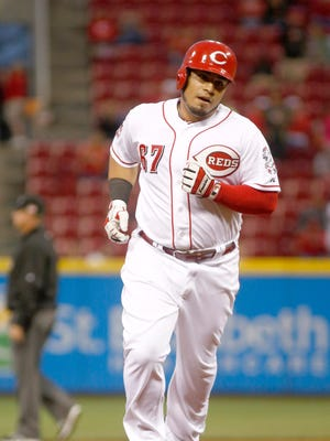 Cincinnati Reds catcher Ramon Cabrera rounds the bases after hitting a solo home run against the St. Louis Cardinals in the second inning at Great American Ball Park.