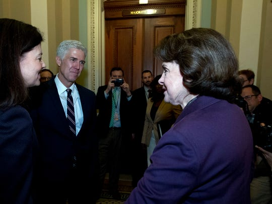 Supreme Court Justice nominee Neil Gorsuch, accompanied by former New Hampshire Sen. Kelly Ayotte, left, meets with Sen. Dianne Feinstein D-Calif., ranking member of the Senate Judiciary Committee, on Capitol Hill in Washington, Wednesday, Feb. 1, 2017.