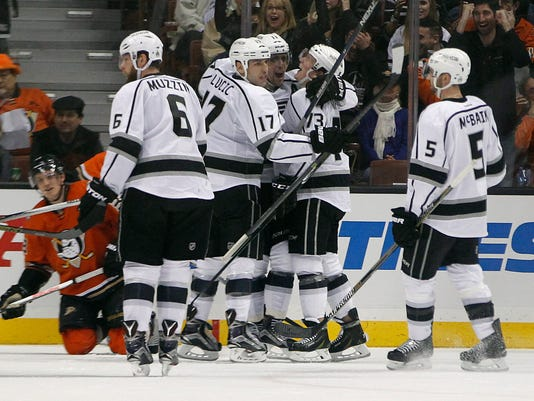Los Angeles Kings left wing Milan Lucic (17) and center Anze Kopitar, center, of Slovenia, celebrate a goal by center Tyler Toffoli, second from right, with defenseman Jake Muzzin (6) and Jamie McBain (5) looking on against the Anaheim Ducks during the second period of an NHL hockey game in Anaheim, Calif., Sunday, Jan. 17, 2016. (AP Photo/Alex Gallardo)