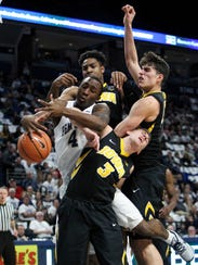 Penn State Nittany Lions guard Nazeer Bostick (4) and