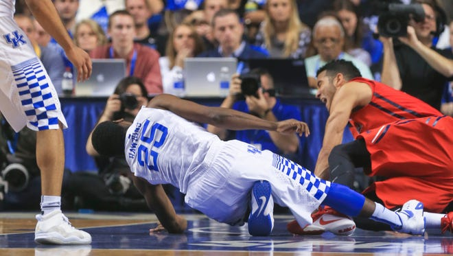 Kentucky's Dominique Hawkins fell to the floor in the second half after injuring his left ankle in the game against Ole Miss.