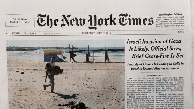 New York Times ran a cover photo the Gaza beach bombing, showing the corpse of a boy who died in the attack.