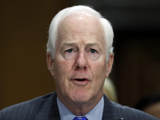 FILE - In this Sept. 19, 2017 file photo, Sen. John Cornyn, R-Texas, testifies during a hearing of the Senate Foreign Relations Committee on Capitol Hill in Washington. A bipartisan group of senators has introduced legislation designed to ensure federal and state governments accurately report relevant criminal history records to the FBI's database of prohibited gun buyers. (AP Photo/Alex Brandon)