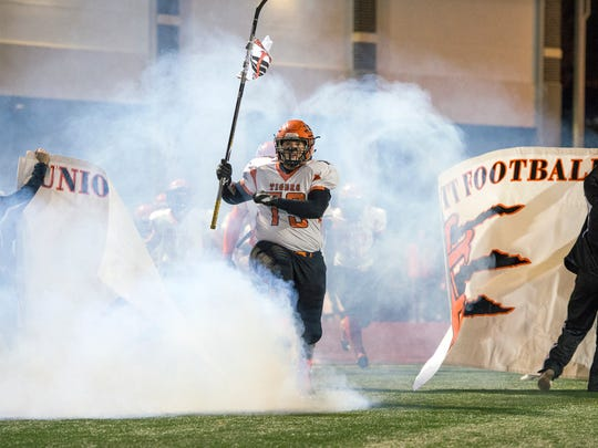 Union-Endicott senior Jacob Broder leads the Tigers onto the field before taking on Vestal in the Section 4 Class A final on Friday, Nov. 4, 2016.