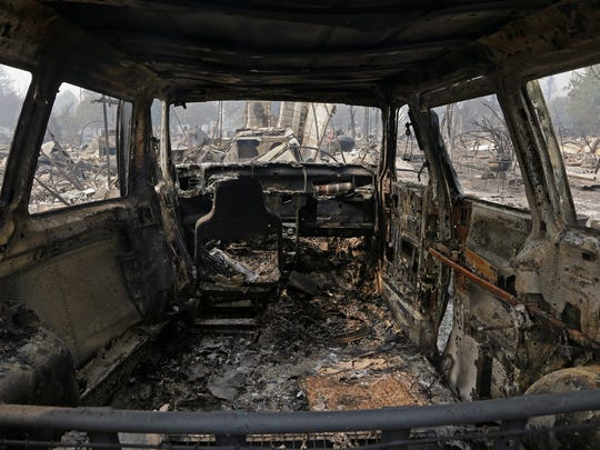 This is a view from inside a parked car destroyed by fire in the Coffey Park area of Santa Rosa. An onslaught of wildfires across a wide swath of Northern California broke out almost simultaneously then grew exponentially, swallowing up properties from wineries to trailer parks and tearing through both tiny rural towns and urban subdivisions.