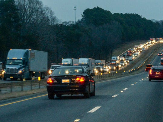 Cars and trucks are backed up Southbound for over four miles from the Southbound bridge over Three and Twenty Creek of Lake Hartwell on I-85 in at the 14 mile Anderson County on Tuesday.
