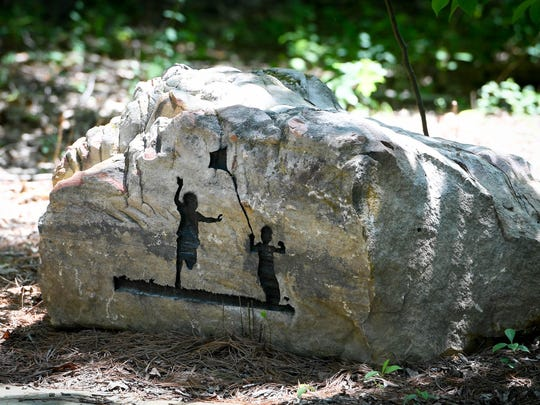 Reliefs cut into stones surrounding a meeting area at the new Wesselman Nature Society's Nature Playscape at Wesselman Woods. Opening this Saturday, the three acre Playscape is the largest of it's kind in the country and is designed to allow unstructured play activities for children in a woods environment Wednesday, May 23, 2018.
