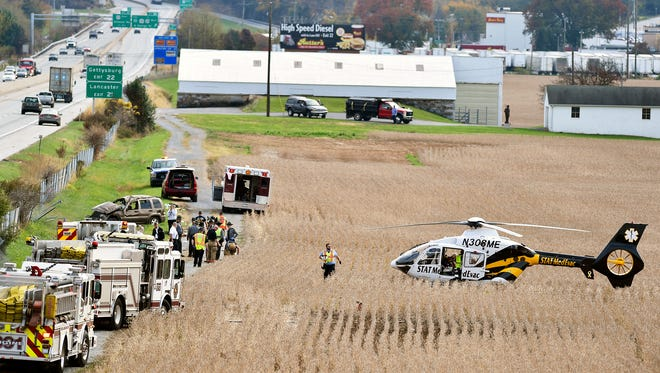 Emergency responders work the scene of a single-vehicle crash on I-83 South, north of the North George Street exit in Manchester Township, Friday, Nov. 3, 2017. Patients were transported by ambulance and a medical helicopter, while southbound traffic was restricted to a single lane.