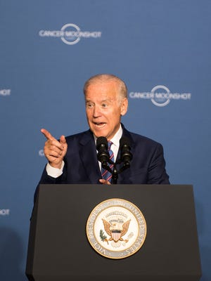 "Vice President Joe Biden speaks during the Cancer Moonshot Summit at Howard University in Washington, D.C., on Wednesday. Biden called for ""a decade's worth of progress in five years"" in cancer research."