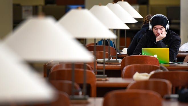 St. Cloud State University student Kyle Rutten focuses on writing a final paper for his English class Wednesday, Dec. 14, in the James W. Miller Learning Resources Center. Students are finishing the fall semester this week with commencement Friday at 1 p.m. in Halenbeck Hall.