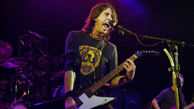 Dave Grohl is seen performing with the Foo Fighters in 2000, the year he talked to IndyStar about talk-show hosts who love his band.